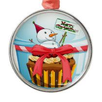 A disposable cup with a cupcake and a snowman insi metal ornament
