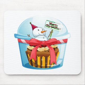 A disposable cup with a cupcake and a snowman insi mouse pad