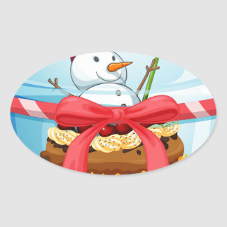 A disposable cup with a cupcake and a snowman insi oval sticker