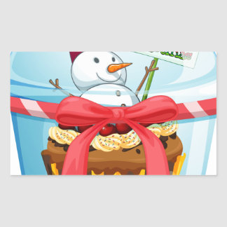 A disposable cup with a cupcake and a snowman insi rectangular sticker