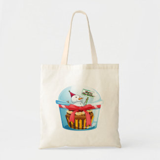A disposable cup with a cupcake and a snowman insi tote bag
