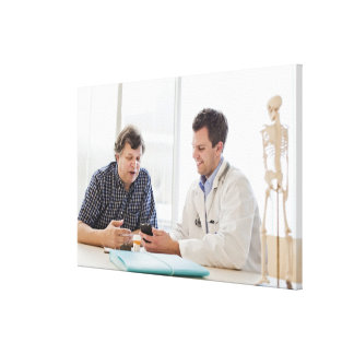 A doctor meeting with a patient and talking and gallery wrap canvas