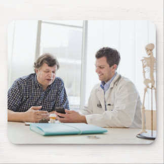 A doctor meeting with a patient and talking and mouse pad