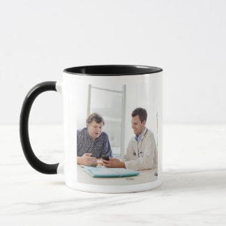 A doctor meeting with a patient and talking and mug