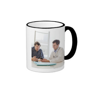 A doctor meeting with a patient and talking and ringer mug