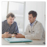 A doctor meeting with a patient and talking and large square tile