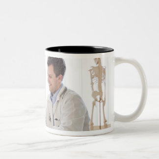 A doctor meeting with a patient and talking and Two-Tone coffee mug