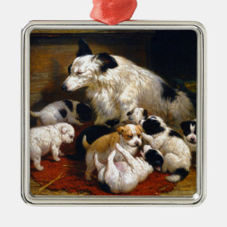 A dog and her puppies metal ornament