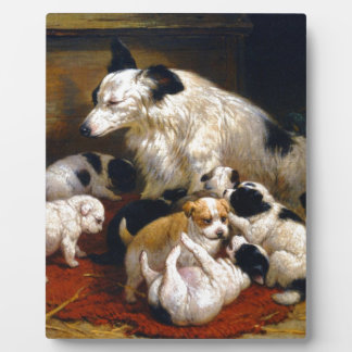 A dog and her puppies plaque
