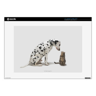 """A dog looking at a cat 15"""" laptop skins"""