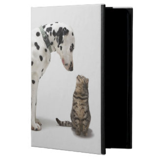 A dog looking at a cat cover for iPad air