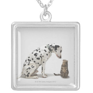 A dog looking at a cat silver plated necklace