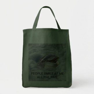 A dolphins best smile tote bag