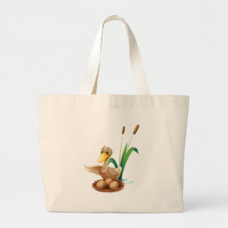 A duck watching the eggs at the nest near the pond jumbo tote bag