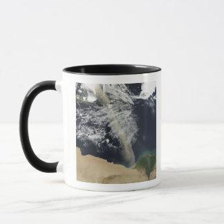A dust plume mug