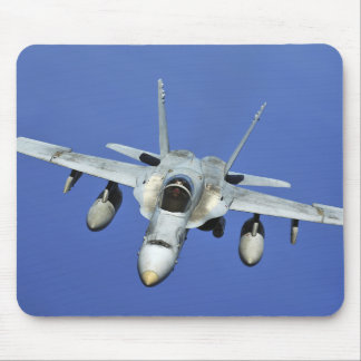 A F/A-18 Hornet participates in a mission Mouse Pad