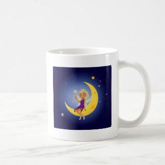 A fairy holding a wand sitting at the moon basic white mug