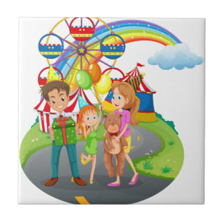 A family at the amusement park small square tile