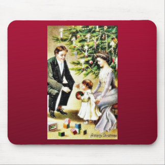 A family celebrates with their kid infront of a ch mouse pad