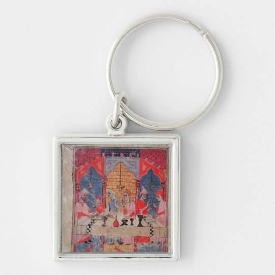 A family gathered at the table for Passover Keychain