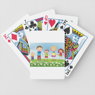 A family in the garden bicycle playing cards