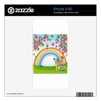 A family strolling with a rainbow and floating bal decal for the iPhone 4