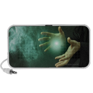 A fantasy wizard making magic with his hands. notebook speakers