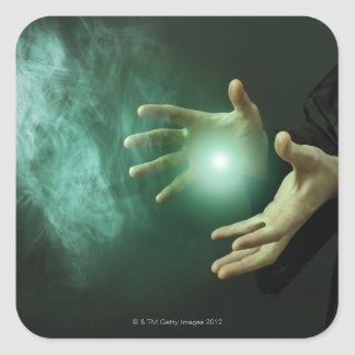 A fantasy wizard making magic with his hands. square sticker