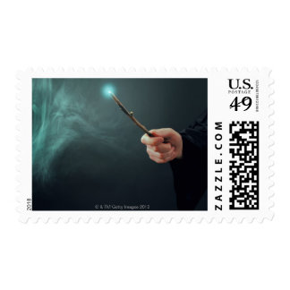 A fantasy wizard making magic with wand. postage