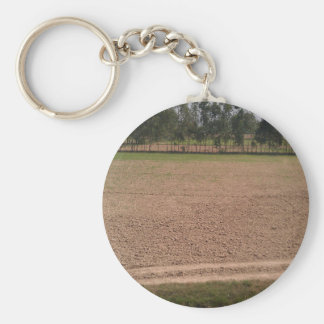 A farm field ready for planting of crops keychain