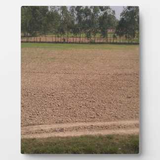 A farm field ready for planting of crops photo plaque