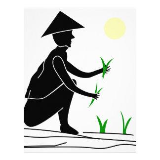 A farmer working in rice fields letterhead