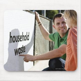 A father teaching his daughter about recycling mouse pad