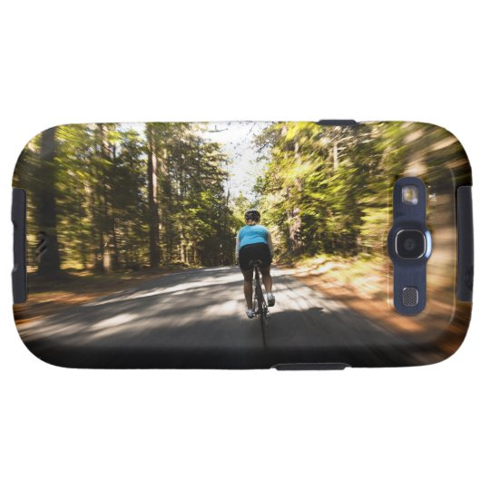 A female cyclist quickly rides on a small narrow samsung galaxy s3 case