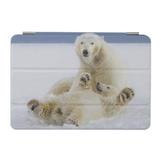 A female polar bear and her cub play in the snow iPad mini cover