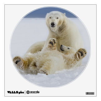 A female polar bear and her cub play in the snow wall sticker