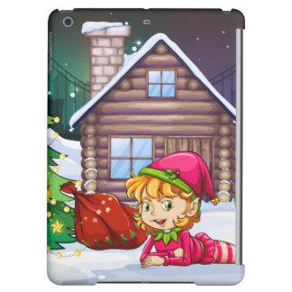A female Santa elf near the christmas tree