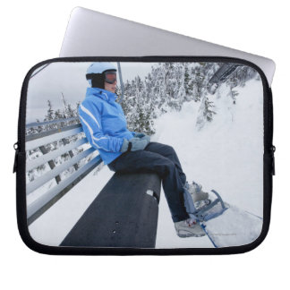A female snowboarder rides the chair lift in New Laptop Sleeve
