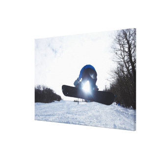 A female snowboarder takes air in New Hampshire. Canvas Print