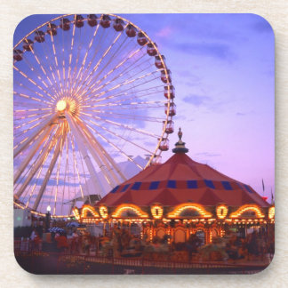 A ferris wheel and carousel at the Navy Pier in Coasters