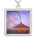 A ferris wheel and carousel at the Navy Pier in Pendant