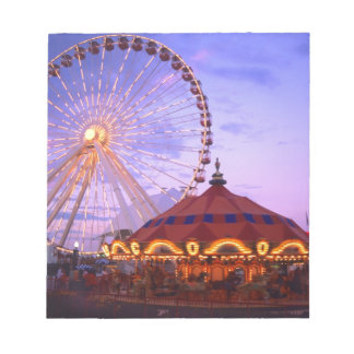 A ferris wheel and carousel at the Navy Pier in Notepad