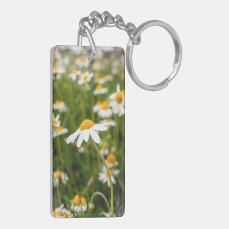 a field of chamomile flowers keychain