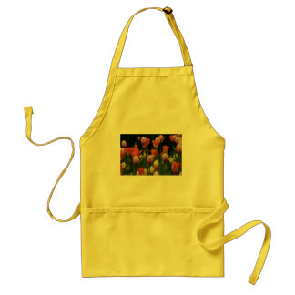 A field of peonies, cyclamens and tulips flowers adult apron