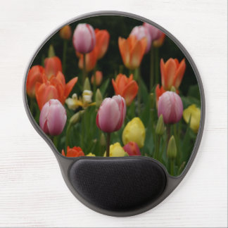 A field of peonies, cyclamens and tulips flowers gel mouse pad