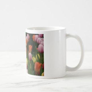 A field of peonies, cyclamens and tulips flowers mug