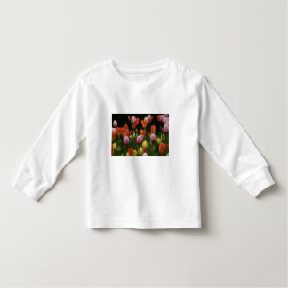 A field of peonies, cyclamens and tulips flowers t-shirt