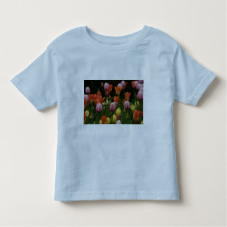 A field of peonies, cyclamens and tulips flowers t shirts