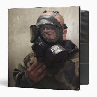 A field radio operator clears CS gas Binder