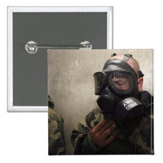 A field radio operator clears CS gas Button